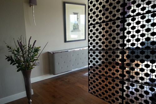 black geodots laser cut metal screen in piano room right side
