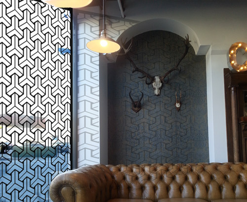 geometric triangles laser cut window screens in picture cafe